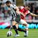 Newcastle United's Hatem Ben Arfa, left, vies for the ball with Arsenal's Santi Cazorla during their English Premier League soccer match at St James' Park, Newcastle, England, Sunday, May 19, 2013. (AP Photo/Scott Heppell)
