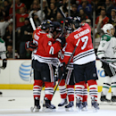 Chicago Blackhawks defenseman Brent Seabrook (7) celebrates his goal against the Dallas Stars with teammates during the first period of an NHL hockey game on Sunday, Nov. 16, 2014, in Chicago The Associated Press