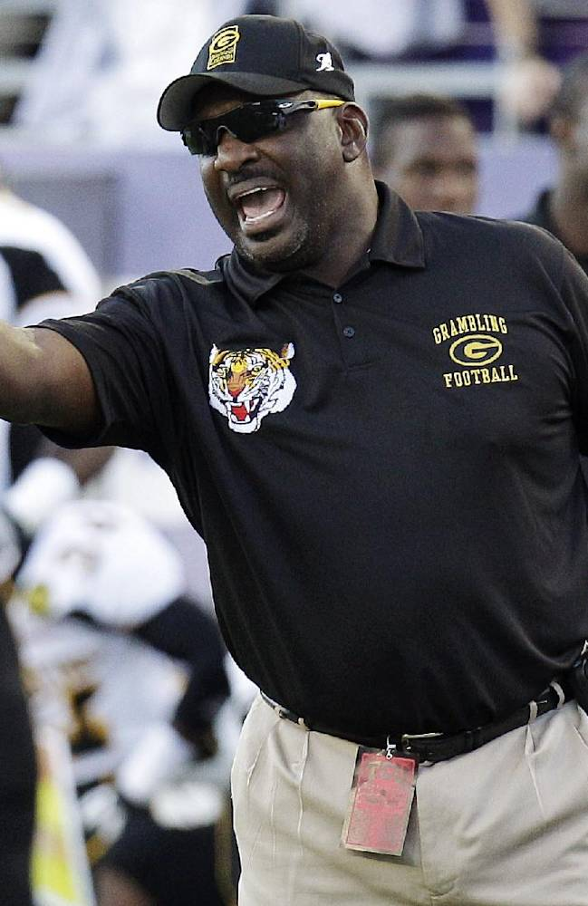 In this Sept. 8, 2012, file photo, Grambling State head coach Doug Williams yells from the sideline during the first half of an NCAA college football game against TCU in Fort Worth, Texas. Williams is coming back to the Washington Redskins to work in the front office. The Redskins announced Monday, Feb. 10, 2014, that the quarterback who led the team to the Super Bowl championship in the 1987 season will serve as a personnel executive