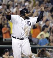 Detroit Tigers' Prince Fielder celebrates while watching a double down the left field line hit by Jhonny Peralta that scored Fielder and Andy Dirks against the Los Angeles Angels in a baseball game Saturday, Aug. 25, 2012, in Detroit. The Tigers defeated the Angels 5-3. (AP Photo/Duane Burleson)