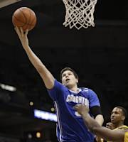 Creighton's Doug McDermott (3) drives against Marquette's Todd Mayo, right, during the second half of an NCAA college basketball game Wednesday, Feb. 19, 2014, in Milwaukee. Creighton won 85-70. (AP Photo/Jeffrey Phelps)