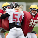 Atlanta Falcons players practice a play with pads during a training session at the Arsenal FC training ground in London Colney, England, Wednesday Oct. 22, 2014. The Falcons will play the Detroit Lions in an NFL football game at London's Wembley Stadium o