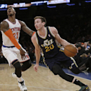 Utah Jazz's Gordon Hayward (20) drives past New York Knicks' Iman Shumpert (21) during the first half of an NBA basketball game on Friday, March 7, 2014, in New York The Associated Press