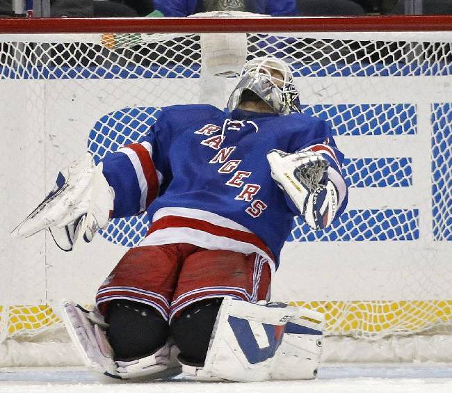 New York Rangers goalie Henrik Lundqvist (30) of Sweden reacts after Los Angeles Kings center Tyler Toffoli (73) scored a goal in the second period of their NHL hockey game at Madison Square Garden in New York, Sunday, Nov. 17, 2013