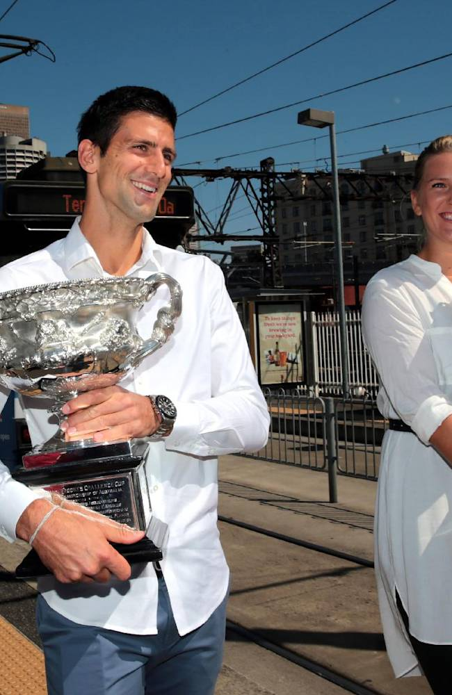 In this photo released by Tennis Australia, defending champions Serbia's Novak Djokovic and Victoria Azarenk of Belarus pose with their trophies prior to the official draw at the Australian Open tennis championship in Melbourne, Australia, Friday, Jan. 10, 2014