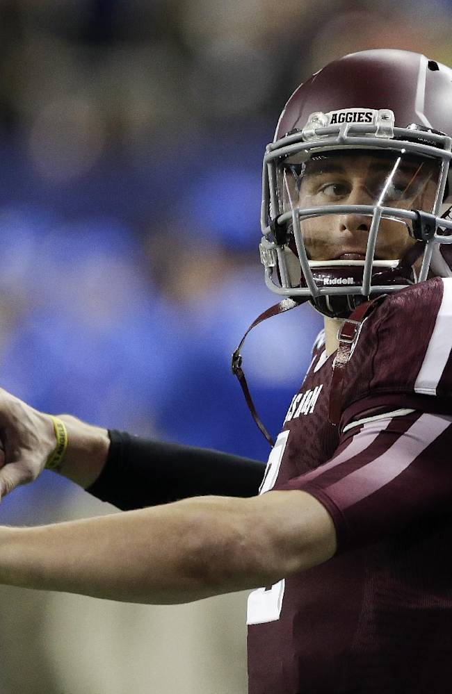 Texas A&M quarterback Johnny Manziel (2) warms up before the start of the Chick-fil-A Bowl NCAA college football game against Duke Tuesday, Dec. 31, 2013, in Atlanta