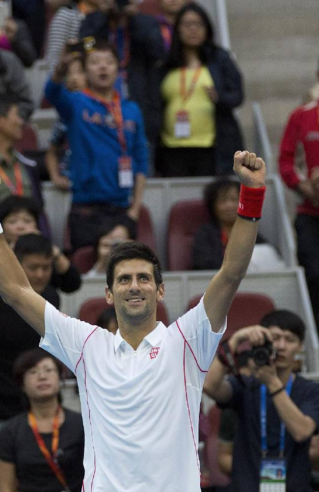 Novak Djokovic of Serbia celebrates after defeated Lukas Rosol of the Czech Republic in the China Open tennis tournament at the National Tennis Stadium in Beijing, China Tuesday, Oct. 1, 2013