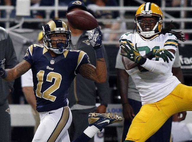 Green Bay Packers cornerback Davon House, right, breaks up a pass intended for St. Louis Rams wide receiver Stedman Bailey during the second quarter of an NFL preseason football game Saturday, Aug. 16, 2014, in St. Louis