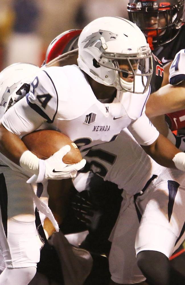 Nevada's Jerico Richardson looks for running room against Fresno State in the second half of an NCAA college football game in Fresno, Calif., Saturday, Nov. 2, 2013
