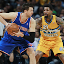 New York Knicks center Andrea Bargnani, left, of Italy, looks to pass the ball as Denver Nuggets forward Wilson Chandler covers in the fourth quarter of the Nuggets' 97-95 victory in an NBA basketball game in Denver on Friday, Nov. 29, 2013 The Associated