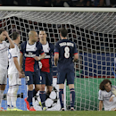 Chelsea's Branislav Ivanovic, left, goalkeeper Petr Cech, right, and David Luiz react after PSG scored their second goal during the Champions League quarterfinal first leg soccer match between PSG and Chelsea, at the Parc des Princes stadium, in Paris, We