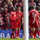 Liverpool's Daniel Sturridge, left, celebrates with teammates after scoring against Southampton during their English Premier League soccer match at Anfield Stadium, Liverpool, England, Sunday Aug. 17, 2014