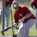 St. Louis Cardinals' Matt Holliday fouls off a ball while working on his bunting during spring training baseball practice Tuesday, Feb. 18, 2014, in Jupiter, Fla The Associated Press