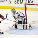 A shot by New Jersey Devils right wing Martin Havlat (9), of the Czech Republic, hits the post as Chicago Blackhawks goalie Scott Darling (33) and defenseman Duncan Keith (2) defend on the play during the third period of an NHL hockey game, Tuesday, Dec.