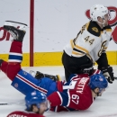 Montreal Canadiens' Max Pacioretty is dumped by Boston Bruins' Dennis Seidenberg during first period NHL hockey action Thursday, Dec. 5, 2013, in Montreal The Associated Press