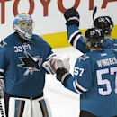 San Jose Sharks goalie Alex Stalock (32) is congratulated by teammates Barclay Goodrow (89) and Tommy Wingels (57) after a 5-2 victory against the Edmonton Oilers in an NHL hockey game Tuesday, Dec. 9, 2014, in San Jose, Calif The Associated Press