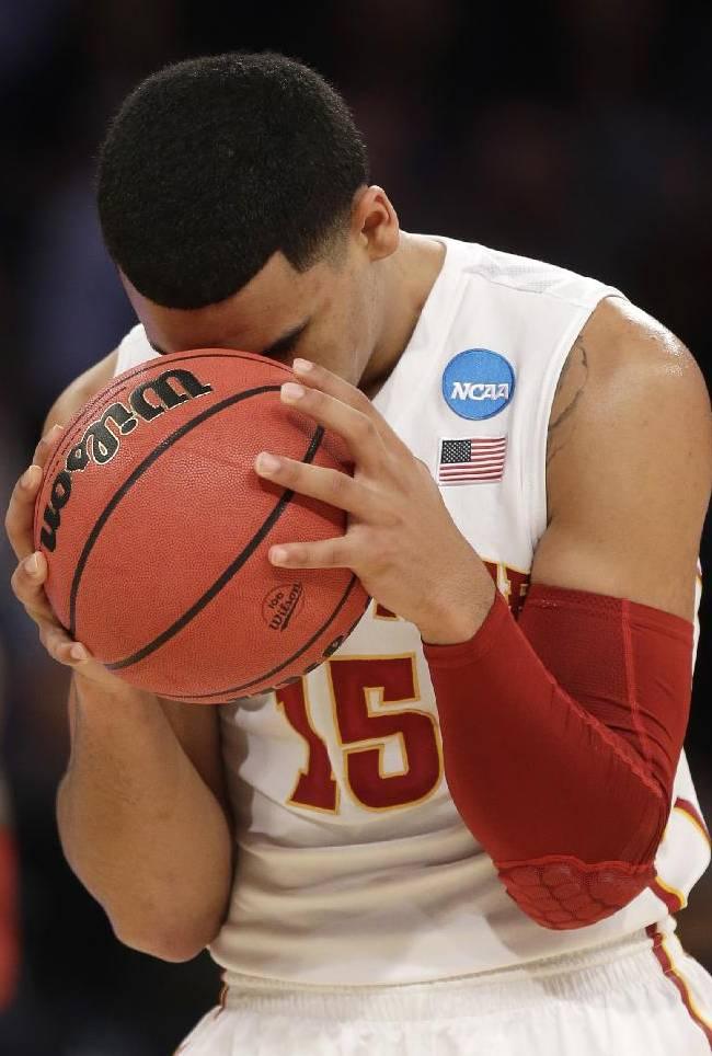 Iowa State's Naz Long holds the ball to his head during the second half in a regional semifinal against Connecticut at the NCAA mens' college basketball tournament, Friday, March 28, 2014 in New York