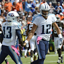 Tennessee Titans wide receiver Kendall Wright (13) celebrates with quarterback Charlie Whitehurst, right, after Wright scored a touchdown against the Cleveland Browns on an 11-yard pass in the second quarter of an NFL football game Sunday, Oct. 5, 2014, i