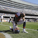 Chicago Bears running back Matt Forte (22) pauses on the field after the Bears' 38-17 loss to the Green Bay Packers in an NFL football game Sunday, Sept. 28, 2014, in Chicago. The Associated Press