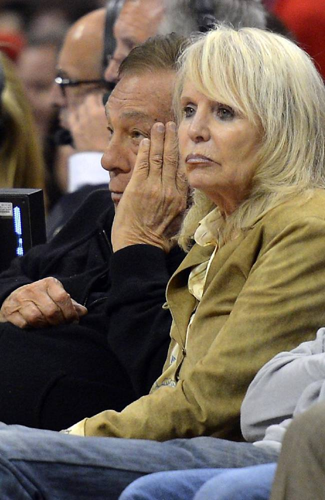 In this May 19, 2012, file photo, Los Angeles Clippers owner Donald Sterling, left, and his wife Rochelle watch during the second half in Game 3 of an NBA basketball playoffs Western Conference semifinal against the San Antonio Spurs in Los Angeles. An attorney representing the estranged wife of Clippers owner Donald Sterling said Thursday, May 8, 2014, that she will fight to retain her 50 percent ownership stake in the team