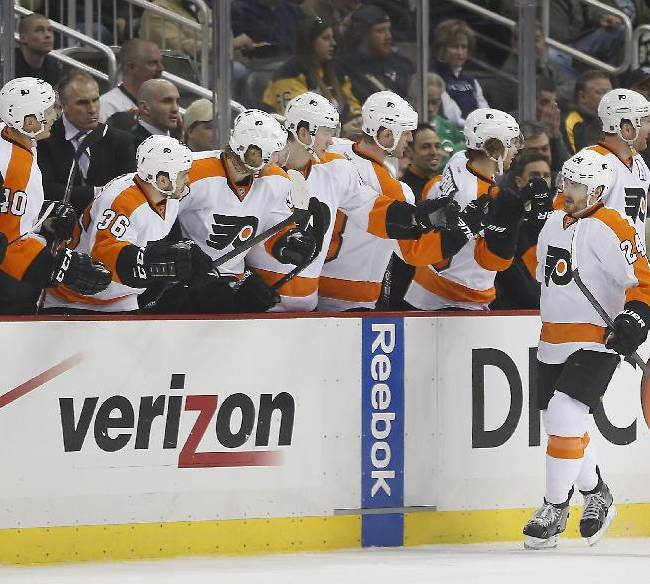 Teamates on the bench greet Philadelphia Flyers' Matt Read after he scored a short-handed goal against the Pittsburgh Penguins during the second period of an NHL hockey game on Sunday, March 16, 2014, in Pittsburgh