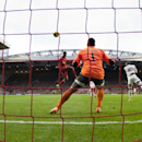 Liverpool's Daniel Sturridge, centre left, scores his second goal past Swansea City goalkeeper Michel Vorm during their English Premier League soccer match at Anfield Stadium, Liverpool, England, Sunday Feb. 23, 2014