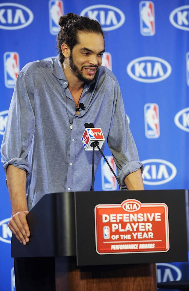 Chicago Bulls center Joakim Noah, answers questions from the media after being named the NBA's Defensive Player of the Year, Monday, April 21, 2014, in Lincolnshire, Ill