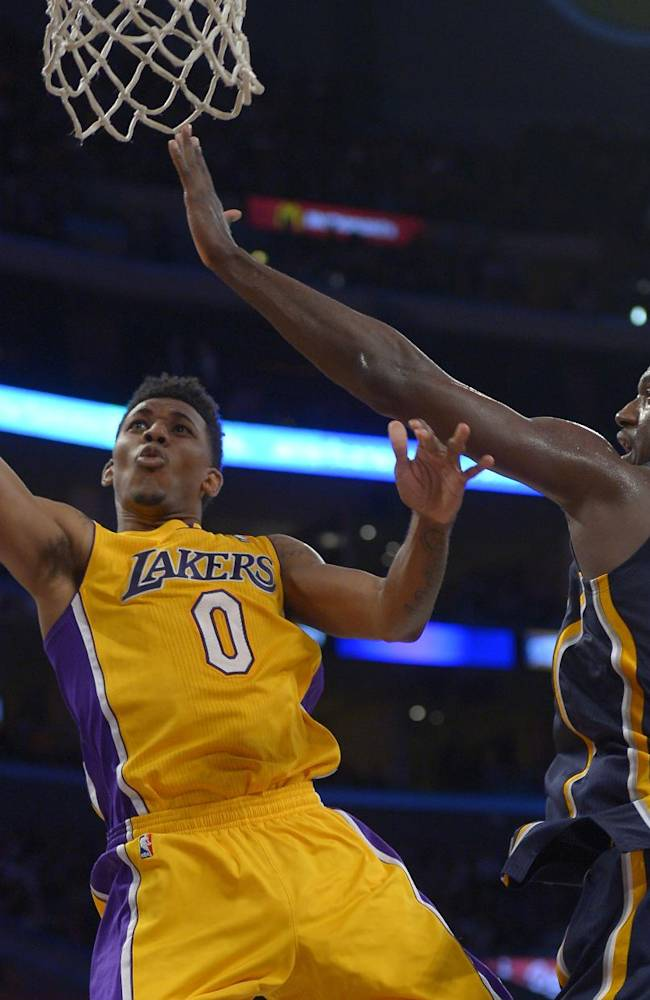 Los Angeles Lakers forward Nick Young puts up a shot as Indiana Pacers center Roy Hibbert defends during the second half of an NBA basketball game, Tuesday, Jan. 28, 2014, in  Los Angeles