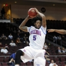 Louisiana Tech's Chris Anderson grabs a rebound during the first half of a Western Athletic Conference tournament NCAA college basketball game against UTSA, Thursday, March 14, 2013, in Las Vegas. (AP Photo/David Becker)