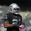 Oakland Raiders running back Maurice Jones-Drew (21) warms up before an NFL football game against the Arizona Cardinals in Oakland, Calif., Sunday, Oct. 19, 2014. (AP Photo/Marcio Jose Sanchez)