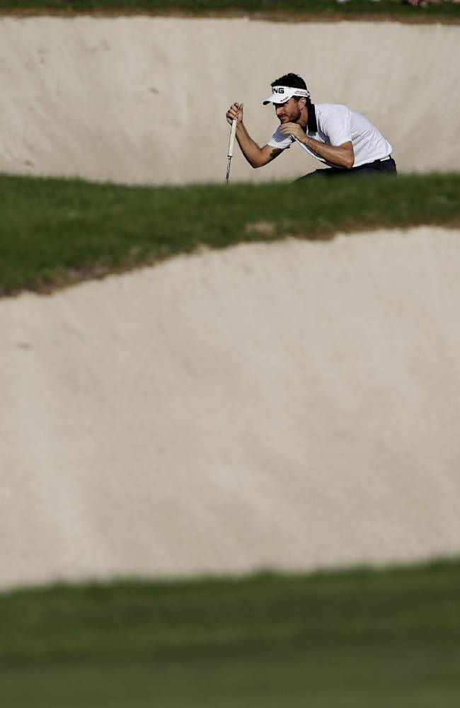 Alejandro Canizares from Spain studies a shot during the 3rd round of the World Tour Golf Championship in Dubai, United Arab Emirates, Saturday, Nov. 16, 2013