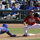 Chicago Cubs' Ryan Kalish, left, dives back to first ahead of the pickoff throw to Cincinnati Reds first baseman Joey Votto in the sixth inning of a spring training exhibition baseball game Saturday, March 8, 2014, in Goodyear, Ariz The Associated Press