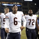 Chicago Bears quarterback Jay Cutler (6) and teammates Shea McClellin and Charles Leno (72) walk off the field after a preseason NFL football game, Friday, Aug. 22, 2014, in Seattle. The Seahawks won 34-6 The Associated Press