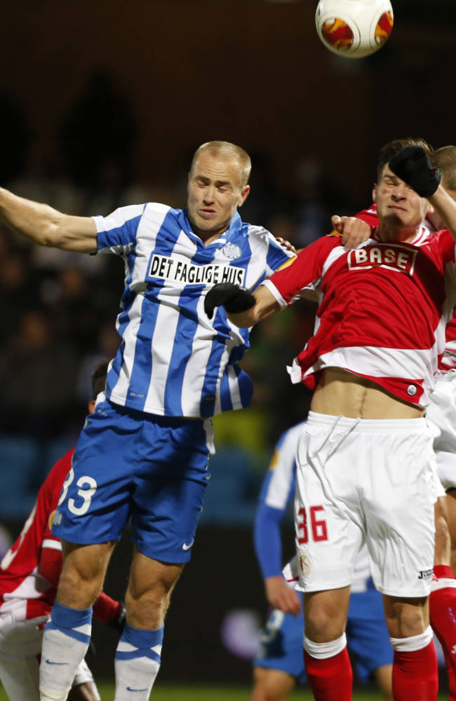 Esbjerg fB's Jens Berthel Askou, centre left,  fights for the ball with Standard Lige's Dino Arslanagic during the Europa League Group C soccer match between in Esbjerg, Denmark, Thursday, Nov. 28, 2013
