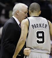 San Antonio Spurs coach Gregg Popovich, left, talks with Tony Parker during the first half of an NBA basketball game against the Cleveland Cavaliers, Saturday, Nov. 23, 2013, in San Antonio. (AP Photo/Eric Gay)