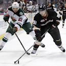 Anaheim Ducks defenseman Alex Grant (51) battles Minnesota Wild right wing Nino Niederreiter (22), of Switzerland for the puck in the first period of an NHL hockey game Wednesday, Dec. 11, 2013 in Anaheim, Calif The Associated Press