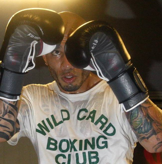 Boxer Miguel Cotto works out at Everlast Lab ahead of his match against Sergio Martinez, Tuesday, June 3, 2014, in Hoboken, N.J. The two will fight for Martinez's WBC middleweight title on June 7 at Madison Square Garden in New York