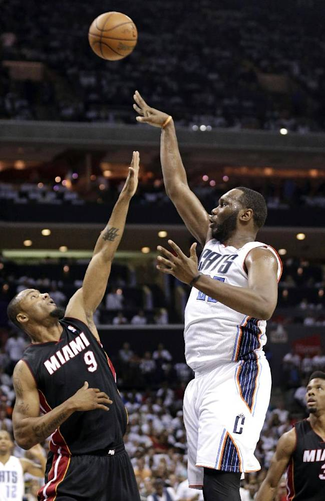 Charlotte Bobcats' Al Jefferson, right, shoots over Miami Heat's Rashard Lewis, left, during the first half in Game 3 of an opening-round NBA basketball playoff series in Charlotte, N.C., Saturday, April 26, 2014