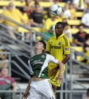 Portland Timbers' Ben Zemanski, left, and Columbus Crew's Kevan George, of Tobago, try to head the ball during the second half of an MLS soccer match on Sunday, July 7, 2013, in Columbus, Ohio. The Crew defeated the Timbers 1-0. (AP Photo/Jay LaPrete)