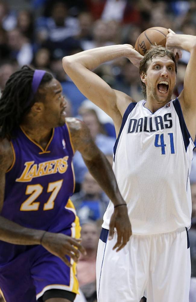 Los Angeles Lakers center Jordan Hill (27) runs up the court as Dallas Mavericks' Dirk Nowitzki (41)prepares to pass after grabbing a defensive rebound in the second half of an NBA basketball game, Tuesday, Nov. 5, 2013, in Dallas. The Mavericks won 123-104