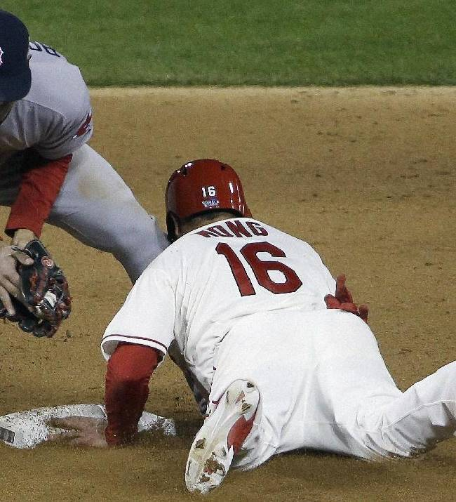 St. Louis Cardinals' Bengie Molina steals second with Boston Red Sox's Xander Bogaerts covering during the eighth inning of Game 3 of baseball's World Series Saturday, Oct. 26, 2013, in St. Louis