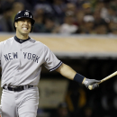 New York Yankees' Mark Teixeira reacts after taking a strike from Oakland Athletics' Jerry Blevins in the eighth inning of a baseball game Tuesday, June 11, 2013, in Oakland, Calif. (AP Photo/Ben Margot)