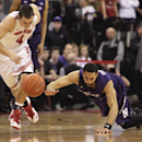 Northwestern's Drew Crawford, right, and Ohio State's Aaron Craft chase a loose ball during the second half of an NCAA college basketball game Wednesday, Feb. 19, 2014, in Columbus, Ohio. Ohio State defeated Northwestern 76-60 The Associated Press