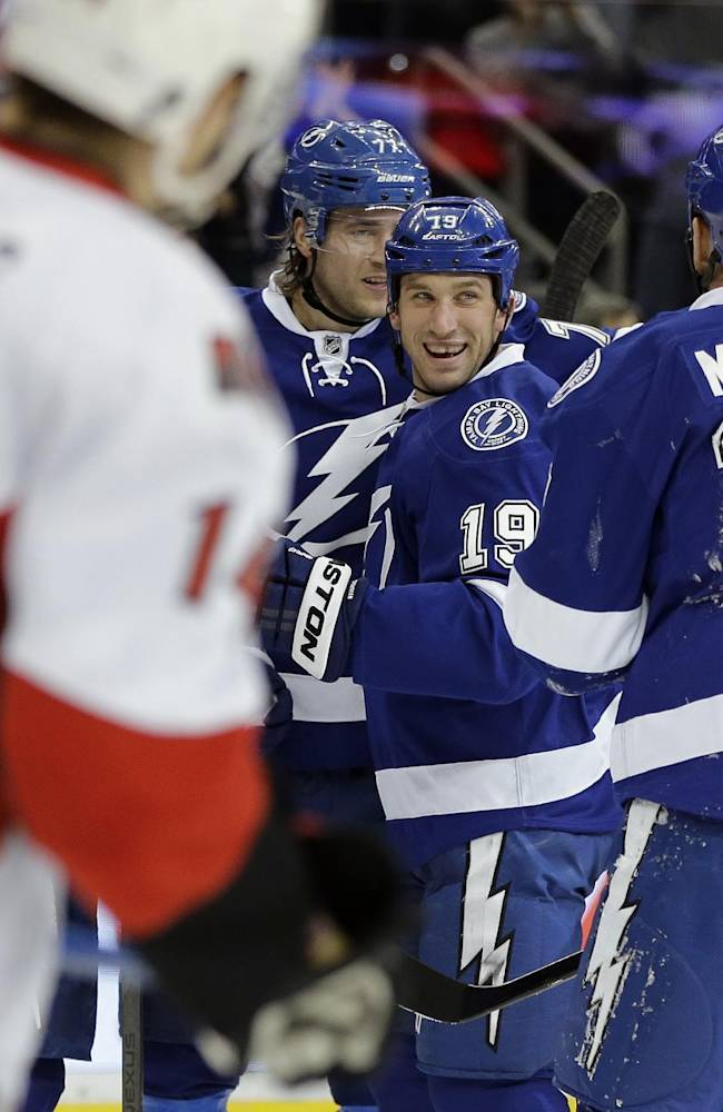 Tampa Bay Lightning right wing B.J. Crombeen (19) celebrates his goal against the Ottawa Senators with teammates, including Ryan Malone (12) during the second period of an NHL hockey game Thursday, Jan. 23, 2014, in Tampa, Fla