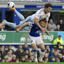 West Ham United's James Tomkins jumps over the top of Everton's Leighton Baines during their English Premier League soccer match at Goodison Park Stadium, Liverpool, England, Saturday March 1, 2014