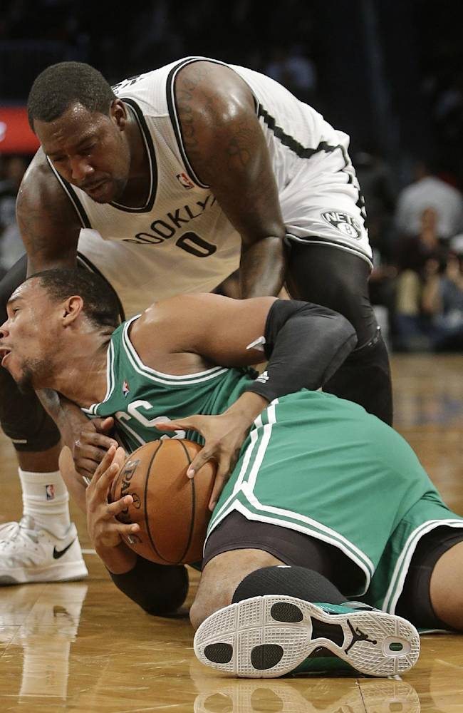 Brooklyn Nets' Andray Blatche (0) and Boston Celtics' Jared Sullinger (7) fight for control of the ball during the second half of a preseason NBA basketball game Tuesday, Oct. 15, 2013, in New York.  The Nets won 82-80
