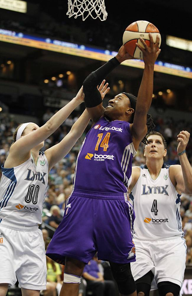Phoenix Mercury guard Alexis Hornbuckle (14) goes to the basket against Minnesota Lynx guard Lindsey Moore (00) during Game 1 of the WNBA basketball playoffs Western Conference finals on Thursday, Sept. 26, 2013, in Minneapolis. The Lynx won 85-62