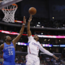Los Angeles Clippers guard Chris Paul shoots over Oklahoma City Thunder forward Kevin Durant during the first half of an NBA basketball game in Los Angeles, Wednesday, April 9, 2014 The Associated Press