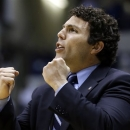 Memphis head coach Josh Pastner urges on his players in the first half of an NCAA college basketball game against Xavier, Tuesday, Feb. 26, 2013, in Cincinnati. (AP Photo/Al Behrman)