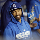 Los Angeles Dodgers' Matt Kemp smiles in the dugout before the Dodgers' exhibition baseball game against the Los Angeles Angels in Los Angeles, Friday, March 28, 2014 The Associated Press